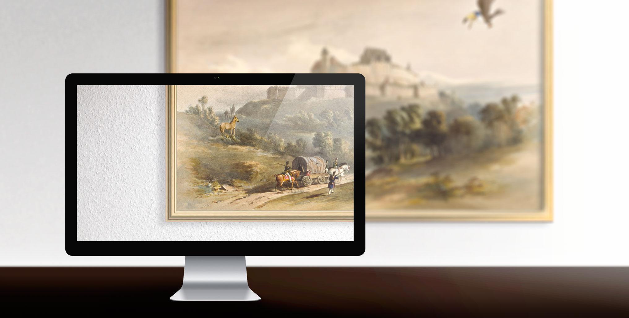 Schreibtisch der Werbeagentur in Coburg mit Veste Coburg im Hintergrund